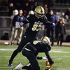 CARL RUSSO/Staff photo.  Haverhill exchange student, Jakob Wimmer of Germany kicks the extra point with Dryden Fisher holding. Haverhill defeated Lexington 42-28 in Friday night football action. 11/15/2019 Haverhill defeated Lexington 42-28 in Friday night football action. 11/15/2019