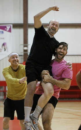 MIKE SPRINGER/Staff photo<br /> Michel Van Ravestyn of Haverhill is lifted into the air by teammates Sal DeFranco, right, and Matt Titus, both also of Haverhill, after a big comeback for the Rotary Club team during in the Chamber Business After Hours third-annual dodgeball tournament Wednesday at the Plaistow Community YMCA. The event collects food and gifts for the YMCA's Giving Trees, which are located in the lobbies of the Plaistow and Haverhill YMCAs. The collected items will be distributed to families in need.<br /> 11/20/2019