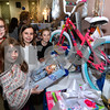 CARL RUSSO/Staff photo. The young ladies take a close look at the toys being raffled at the festival. From left, Coco Kinley, 6; Sabrina Tzitzon, 9 and Nina Kinley, 10. Lila Tzitzon, 11, (background). They are all from Andover. The Annual Greek Festival sponsored by the Holy Apostles Saints Peter and Paul Greek Orthodox church in Haverhill was held November 1, 2. <br /> <br /> The event, held at the Hellenic Community Center, will continue on Sunday, November 3 with plenty of  authentic Greek cuisine such as lamb shanks, souvlaki, moussaka, pastichio, spinach pie, and other specialties.11/01/2019