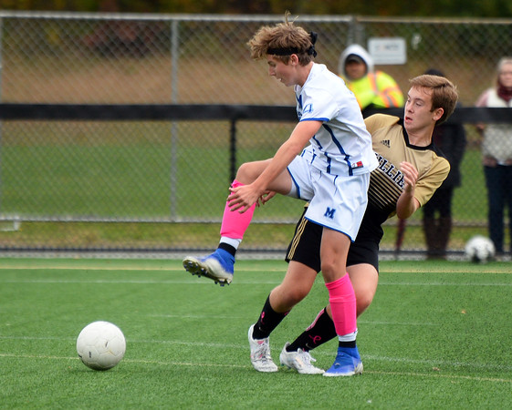 CARL RUSSO/Staff photo Haverhill's Jaden Shaut, right and Methuen's Colby Keaney fight for the ball. Haverhill defeated Methuen 4-0 in boys soccer action Tuesday afternoon. 10/22/2019