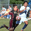 CARL RUSSO/Staff photo. Whittier's Gabe Morales fights to control the ball. Whittier Tech. defeated the Minuteman 3-0 in boys soccer action Monday afternoon. 9/16/2019