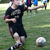 CARL RUSSO/Staff photo. Whittier's Parker Jennings kicks the ball on net.  Whittier Tech. defeated the Minuteman 3-0 in boys soccer action Monday afternoon. 9/16/2019
