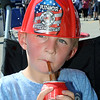 CARL RUSSO/Staff photo. Alex Sciuto, 4, of Haverhill is a junior firefighter for the day. Team Haverhill's River Ruckus 2019 was held Saturday in downtown Haverhill on Washington Street. 9/21/2019