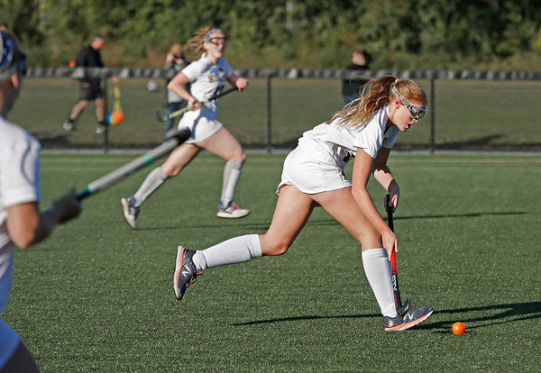 MIKE SPRINGER/Staff photo<br /> Haverhill's Nora Hess drives the ball upfield during varsity field hockey play Wednesday against Lawrence at Haverhill.<br /> 9/18/2019
