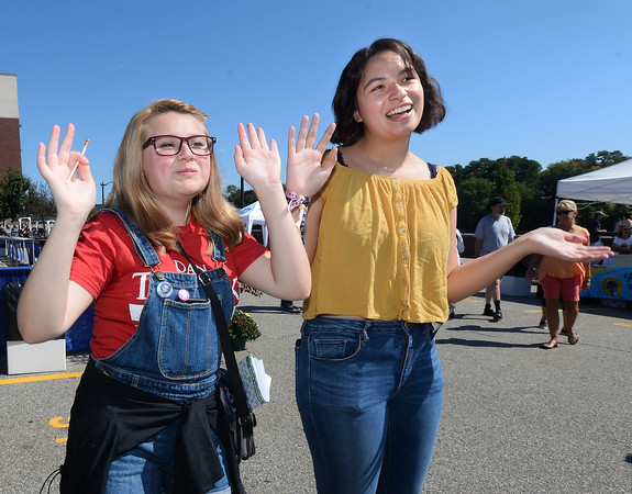 CARL RUSSO/Staff photo. Adriana Byrne, left, a junior at Whittier Tech high school and Bella Houde, a junior at Haverhill high, both 16, dance to the music of the rock group, The Life of The Party as they perform on stage. Team Haverhill's River Ruckus 2019 was held Saturday in downtown Haverhill on Washington Street. 9/21/2019