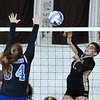 CARL RUSSO/Staff photo Haverhill's Kyalee Burdier spikes the ball over the net as Methuen captain Kate McDonnell defends. Haverhill high defeated Methuen 3-0 in volleyball action at Haverhill high school Wednesday afternoon. 9/11/2019