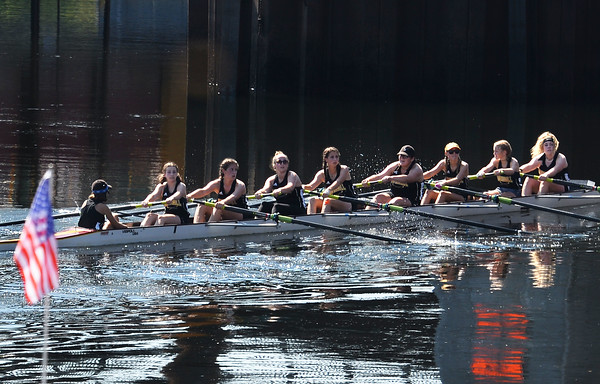 CARL RUSSO/Staff photo. Haverhill high crew team rows pass the River Ruckus area. Team Haverhill's River Ruckus 2019 was held Saturday in downtown Haverhill on Washington Street. 9/21/2019