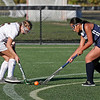 MIKE SPRINGER/Staff photo<br /> Haverhill's Hailey Corliss, left, competes for the ball with Jadelyn Him of Lawrence during varsity field hockey play at Haverhill<br /> 9/18/2019