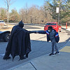 ALLISON CORNEAU/Staff photo<br /> Batman greets a young fan with a COVID-friendly fist bump at Bradford Elementary School.
