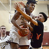 CARL RUSSO/Staff photo Whittier's Yuki Efosa Aguebor fights hard for the rebound against Greater Lawrence's Antonio Valenzuela. Greater Lawrence Tech. defeated Whittier Tech. 53-42 in boys' basketball action. 2/03/2020