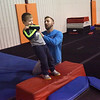 TIM JEAN/Staff photo <br /> <br /> Matthew Chmielewski, YMCA Instructor, teaches Easton Binder, 4, of Plaistow, how to fall back and not hurt himself as he learns how to navigate through the Ultimate Ninja obstacle course at the Plaistow Community YMCA.     2/22/20