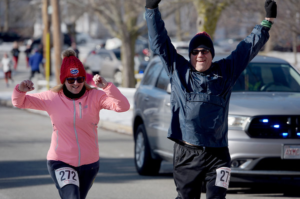 TIM JEAN/Staff photo <br /> <br /> <br /> Runners celebrate finishing the annual Bradford Valentine Road Race. Finishers received a small box of chocolates, commemorative medal, and a Valentines flower.  2/8/20