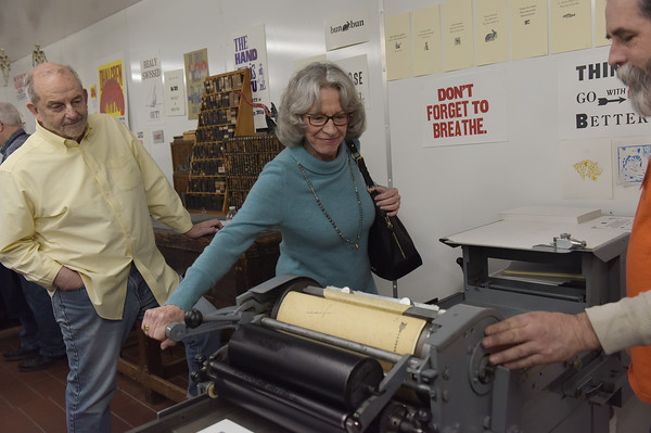 TIM JEAN/Staff photo <br /> <br /> Janice Lomas, of Peabody, turns the handle as she learns how to print in the letterpress studio during Hot Metal Day at the Museum of Printing in Haverhill.   2/1/20
