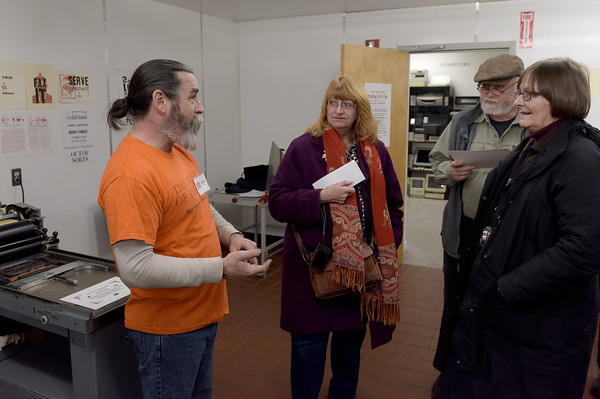 TIM JEAN/Staff photo <br /> <br /> Printer Craig Busteed, left, talks about how he uses the letterpress studio printers to Pauline and Gerry Connors, and Loretta Cappabianca, during Hot Metal Day at the Museum of Printing in Haverhill.   2/1/20