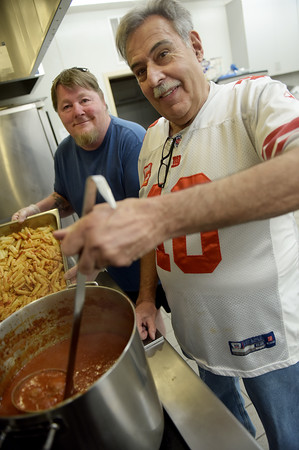 TIM JEAN/Staff photo <br /> <br /> In the kitchen are Bob LaFountain, left, of Plaistow, and Larry Gaiero, of Haverhill, during the Haverhill Sons of Italy pasta dinner in the basement of All Saints Church. The dinner featured salad, pasta, bread, and meatballs made by Larry Gaiero, the winner of last year's meatball cooking contest.    2/22/20