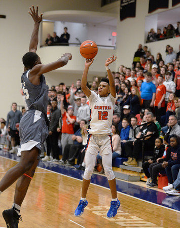 CARL RUSSO/Staff photo. Central's Xavier McKenzie takes the jump shot over Haverhill's Jeremyah Phillips. Central Catholic defeated Haverhill in boys basketball in D1 North opener Monday night.  2/24/2020.
