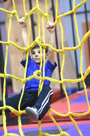 TIM JEAN/Staff photo <br /> <br /> Jacob Limbo, 4, of Atkinson, climbs up the rope wall as he makes his way through the Ultimate Ninja obstacle course at the Plaistow Community YMCA.     2/22/20