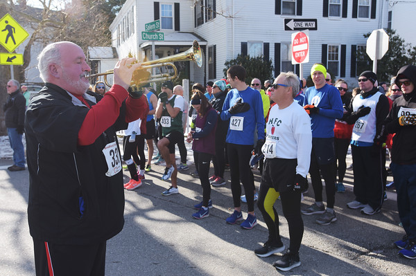 TIM JEAN/Staff photo <br /> <br /> <br /> A trumpeter plays the National Anthem before the start of the annual Bradford Valentine Road Race. Finishers received a small box of chocolates, commemorative medal, and a Valentines flower.  2/8/20