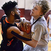 CARL RUSSO/Staff photo Greater Lawrence's Chris Tineo, left and Whittier's Peter Byram fight for the ball. Greater Lawrence Tech. defeated Whittier Tech. 53-42 in boys' basketball action. 2/03/20200