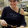 TIM JEAN/Staff photo <br /> <br /> Renee Ouellette, of Haverhill, serves up dinner during the Haverhill Sons of Italy pasta dinner in the basement of All Saints Church. The dinner featured salad, pasta, bread, and meatballs made by Larry Gaiero, the winner of last year's meatball cooking contest.    2/22/20