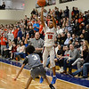 CARL RUSSO/Staff photo. Central's Xavier McKenzie takes the jump shot over Haverhill's Angel Burgos. Central Catholic defeated Haverhill in boys basketball in D1 North opener Monday night.  2/24/2020.