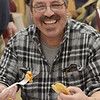 TIM JEAN/Staff photo <br /> <br /> Joe Barbuti, of Haverhill, sits down to eat dinner after working in the kitchen during the Haverhill Sons of Italy pasta dinner in the basement of All Saints Church. The dinner featured salad, pasta, bread, and meatballs made by Larry Gaiero, the winner of last year's meatball cooking contest.    2/22/20