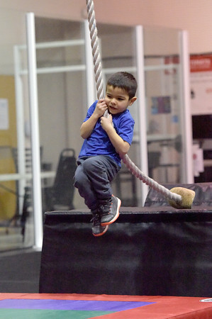 TIM JEAN/Staff photo <br /> <br /> Levi Cabral, 5, of Hampstead, jumps up and swings across the opening as he makes his way through the Ultimate Ninja obstacle course at the Plaistow Community YMCA.     2/22/20