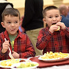 TIM JEAN/Staff photo <br /> <br /> Twin brothers Lorenzo, left, and Giovani Brandolini, 4, grandsons to club members, enjoy dinner during the Haverhill Sons of Italy pasta dinner in the basement of All Saints Church. The dinner featured salad, pasta, bread, and meatballs made by Larry Gaiero, the winner of last year's meatball cooking contest.    2/22/20
