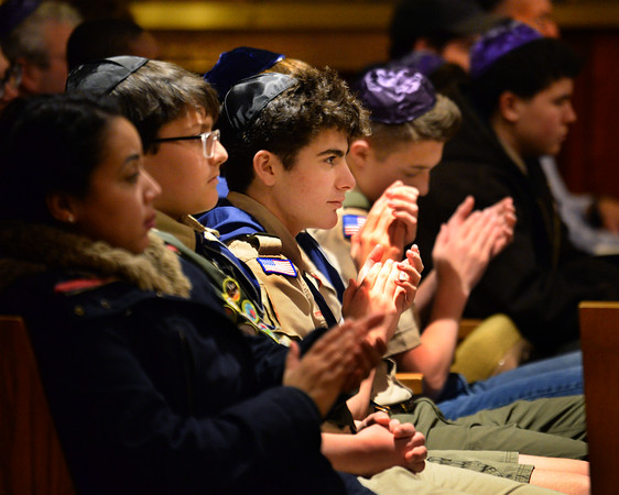CARL RUSSO/Staff photo. Members of Atkinson's Boys Scout Troop 9 of the Atkinson Lions Club attend their first Shabbat and Martin Luther King Jr. service.  <br /> <br /> A Shabbat service and tribute to Martin Luther King Jr., presented in partnership with Calvary Baptist Church of Haverhill was held Friday night at Temple Emanu-El.  Cantor Vera Broekhuysen and Rabbinic Intern Jennifer Stevens conducted the service along with Joe Devoe, music ministries director for Calvary Baptist Church. 1/17/2020