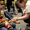 TIM JEAN/Staff photo <br /> <br /> Keri-lyn Rubino, left, helps her son Finn, 18-months old, pet a snake held by Chelsea Holt of Curious Creatures during a live animal program at the Haverhill Public Library.   1/3/20