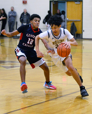 CARL RUSSO/Staff photo. Haverhill's Enrique Alvarado drives to the hoop against Central's Xavier McKenzie. Central Catholic defeated Haverhill 48-39 in boys basketball action Friday night. 1/10/2020