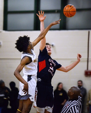 CARL RUSSO/Staff photo. Haverhill's Efosasere Efosa-Aguebor wins the tip off against Central Catholic captain, Anthony Traficante to start the game. Central Catholic defeated Haverhill 48-39 in boys basketball action Friday night. 1/10/2020