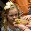 TIM JEAN/Staff photo <br /> <br /> Hadley Morin, 7, pets a bearded dragon during Curious Creatures live animal program at the Haverhill Public Library.   1/3/20