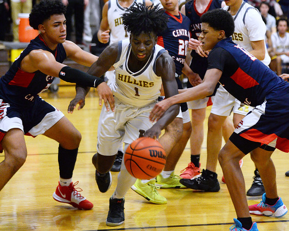 CARL RUSSO/Staff photo. Haverhill's Phillip Cunningham. fights for the loose ball against Central's Marcus Rivera, left and Xavier McKenzie. Central Catholic defeated Haverhill 48-39 in boys basketball action Friday night. 1/10/2020