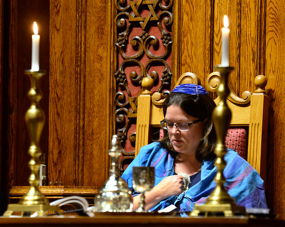 CARL RUSSO/Staff photo. Temple Emanu-El Rabbinic Intern, Jennifer Stevens leads a quiet moment of prayer. <br /> <br /> A Shabbat service and tribute to Martin Luther King Jr., presented in partnership with Calvary Baptist Church of Haverhill was held Friday night at Temple Emanu-El.  Cantor Vera Broekhuysen and Rabbinic Intern Jennifer Stevens conducted the service along with Joe Devoe, music ministries director for Calvary Baptist Church. 1/17/2020