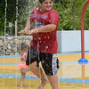 TIM JEAN/Staff photo<br /> <br /> Leo Aguayo, 10, of Haverhill plays in the water at the splash pad at Swasey Park in Haverhill. The park is for Haverhill residents only and is open every day 10am-8pm. 7/11/20