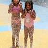 TIM JEAN/Staff photo<br /> <br /> Isabella Solispuleio, 7, left, and her sister Nia, 6, both of Haverhill play in the water at the splash pad at Swasey Park in Haverhill. The park is for Haverhill residents only and is open every day 10am-8pm. 7/11/20