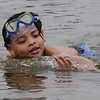 TIM JEAN/Staff photo<br /> <br /> Adriel Rivera, 8, of Haverhill, swims along the beach at Plug Pond recreation area in Haverhill.    6/27/20