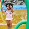 TIM JEAN/Staff photo<br /> <br /> Sofia Mohamed, 3, plays in the water at the splash pad at Swasey Park in Haverhill.     6/27/20