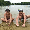 TIM JEAN/Staff photo<br /> <br /> Angel Rivera, left, 10, and his brother Adriel, 8, both of Haverhill, see who can build a bigger sand castle while swimming at Plug Pond recreation area in Haverhill.    6/27/20