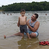 TIM JEAN/Staff photo<br /> <br /> Carlos Galvan of Haverhill, plays in the water with his son Carlos, 3, while swimming at Plug Pond recreation area in Haverhill.    6/27/20