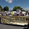 TIM JEAN/Staff photo<br /> <br /> Hundreds of protesters march along Ginty Boulevard yelling while carrying signs during a Black Lives Matter protest and march in Haverhill. The rally started outside of Trinity Stadium and marched to GAR park.   6/13/20