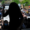 TIM JEAN/Staff photo<br /> <br /> Hannah Bessette is silhouetted as she speaks to the hundreds who gathered for a Black Lives Matter protest and march in Haverhill. The rally started outside of Trinity Stadium and marched to GAR park.   6/13/20
