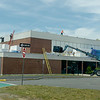 TIM JEAN/Staff photo<br /> <br /> Construction work has started on a new roof for the Charles C. White pool at Haverhill High School.  6/10/20