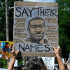 TIM JEAN/Staff photo<br /> <br /> A protesters marches along Water Street while carrying a sign with the portrait of George Floyd on it and other names of those who have died during a Black Lives Matter protest and march in Haverhill. The rally started outside of Trinity Stadium and marched to GAR park.   6/13/20