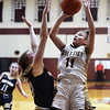 CARL RUSSO/Staff Photo Whittier's Aliyah Talley takes the jump shot over Winthrop's Caroline Earl. Winthrop defeated Whittier Tech. 55-39 in Div. 3 North quarterfinals in girls basketball action Thursday night. 2/27/2020