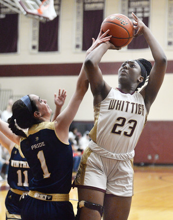 CARL RUSSO/Staff Photo Whittier's Grace Efosa-Aguebor takes the short jumper over Winthrop's Maura Dorr. Winthrop defeated Whittier Tech. 55-39 in Div. 3 North quarterfinals in girls basketball action Thursday night. 2/27/2020