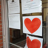CARL RUSSO/Staff photo. Community Action Inc. at 3 Washington Square displays hearts on their door. Several downtown Haverhill businesses are displaying messages of hope in their store windows during the coronavirus crisis. 5/06/2020