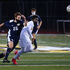 CARL RUSSO/Staff photo.  Andover's Gannon Sylvester, 26 chases the ball with Haverhill player. Down 3-0 at the half, the Haverhill Hillies rallied back to score three goals, ending the game in a tie against Andover in boys' soccer action Wednesday afternoon. 11/04/2020