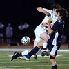 CARL RUSSO/Staff photo. Haverhill's captain, Connor Buscema, left and Andover's Logan Carr collide fighting for the ball. Down 3-0 at the half, the Haverhill Hillies rallied back to score three goals, ending the game in a tie against Andover in boys' soccer action Wednesday afternoon. 11/04/2020
